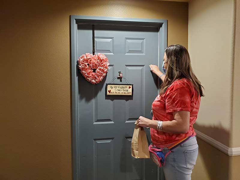 Target volunteer making a delivery to residents