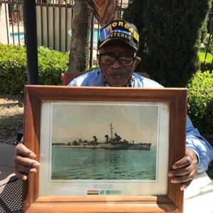 Gardens at Sierra resident and Korean War veteran, Sam, displays a rendering of the ship he served on.