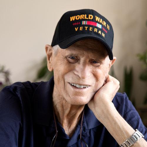 World War II veteran smiling at camera